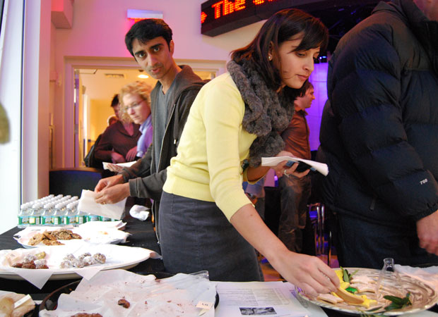 WNYC reporter Arun Venugopal and producer Yasmeen Khan grab a few cookies from what's left of the slam. Photo by Abbie Fentress Swanson