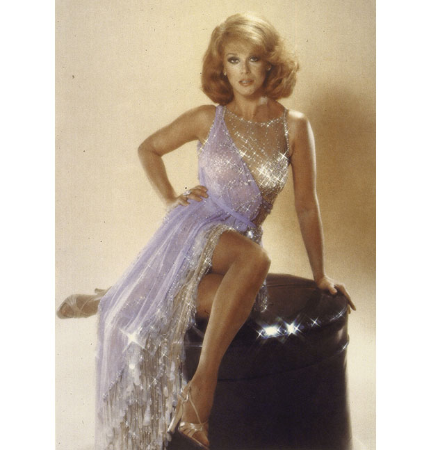 Actress Ann-Margaret wearing a sparkly sliver, low-cut gown by Bob Mackie