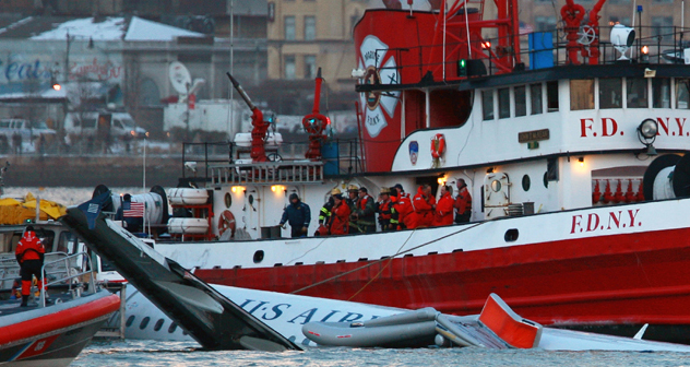 Rescue workers assist a New York City Fire Department boat. (Getty)