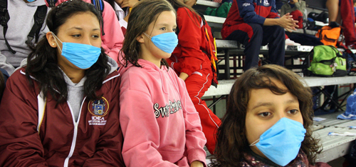 Mexican athletes wear face masks at the Nationals Olympics 2009 in Tijuana on April 26, 2009. The Mexican national games were canceled due to the outbreak of swine flu In Mexico. (Daniel Conejo, AFP/Getty)