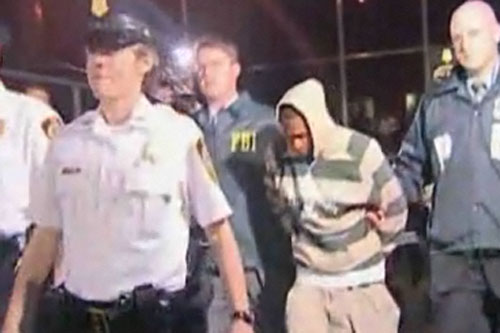 Screen shot from an AP video showing the FBI and NYPD with a terror plot suspect