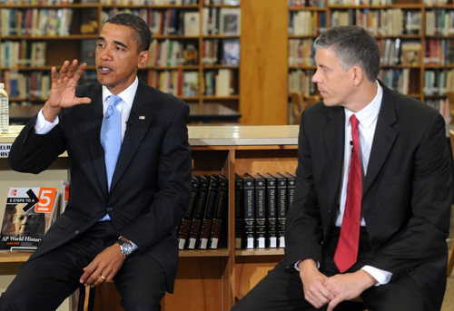 U.S. President Barack Obama (L) and U.S. Education Secretary Arne Duncan host a group discussion with students at Wakefield High School September 8, 2009 in Arlington, Virginia.