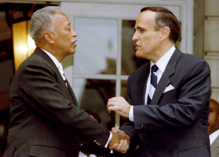 Mayor David Dinkins and Mayor-elect Rudolph Giuliani shake hands on the steps of City Hall November 3,1993. (Don Emmert/AFP/Getty Images)