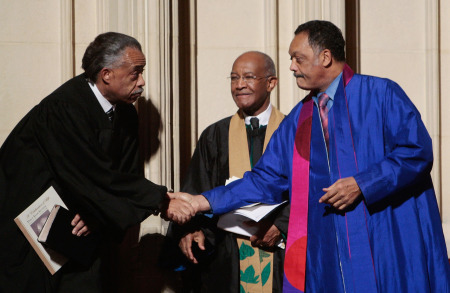 Rev. Al Sharpton (L) and Rev. Jesse Jackson (R) shake hands while Rev. James Forbes looks on at Percy Sutton