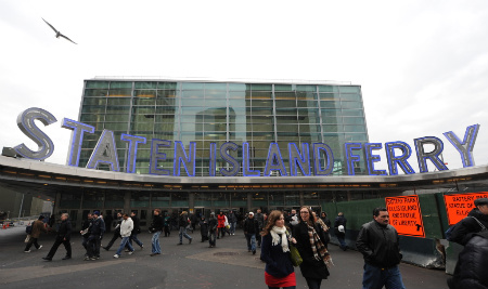 Passengers leave the Staten Island Ferry terminal January 15, 2010 in New York. (Photo: DON EMMERT/AFP/Getty Images)