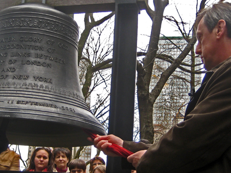 """Russian Consul General Andrey Yushmanov ringing the """"Bell of Hope""""(Photo by Chine Labbe)"""