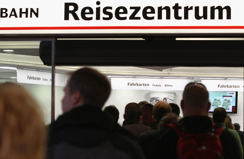 Passengers queue up for tickets at a ticket office at Hauptbahnhof train station in Berlin, Germany looking for alternative routes to return home. (Photo by Andreas Rentz/Getty Images)