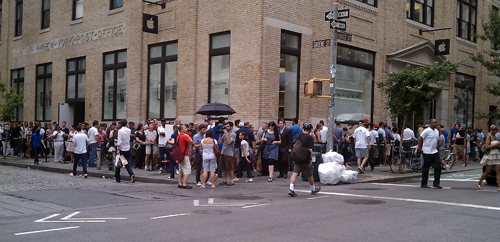 Customers waiting to pick up their iPhones at the Apple store in SoHo (Photo by Kate Hinds)